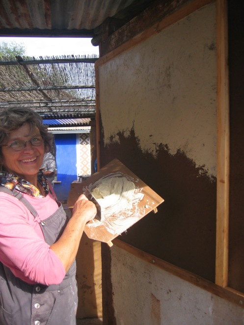 Marcia adding lime plaster to practice square using Japanese style hawk made by Oso Steen.
