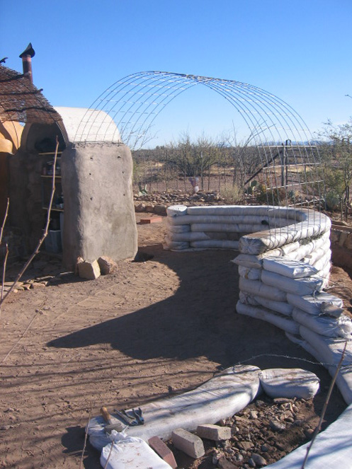 This permanent structure will replace the old outdoor kitchen under the ramada. The base is made of earthbags.  The vault portion is buttressed by Sarah's Closet to the left and a new banco (bench) on the right.