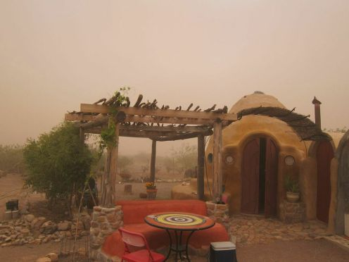 Marveling at the sandstorm, from the safety of the dome, while finishing dinner. Ahhhh, life in the desert!