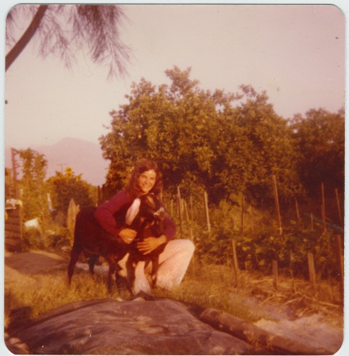 Marcia, her goats and garden by an orange orchard, Coachella Valley, CA, 1975.
